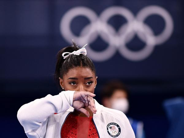 Simone Biles looks on during the women's gymnastics team final during the Tokyo Olympics on Tuesday. After competing on the vault, Biles withdrew from team competition.
