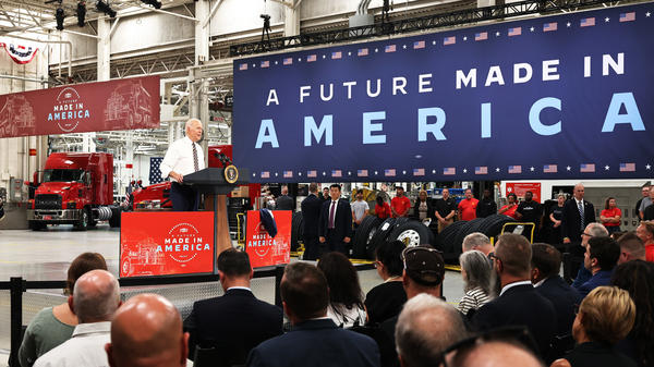 President Biden speaks Wednesday at a Mack Trucks facility in Macungie, Pa., about the importance of U.S. manufacturing and buying products made in America.