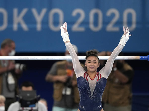 U.S. gymnast Sunisa Lee finishes on the uneven bars during the gymnastics women's all-around final at the Summer Olympics on Thursday.