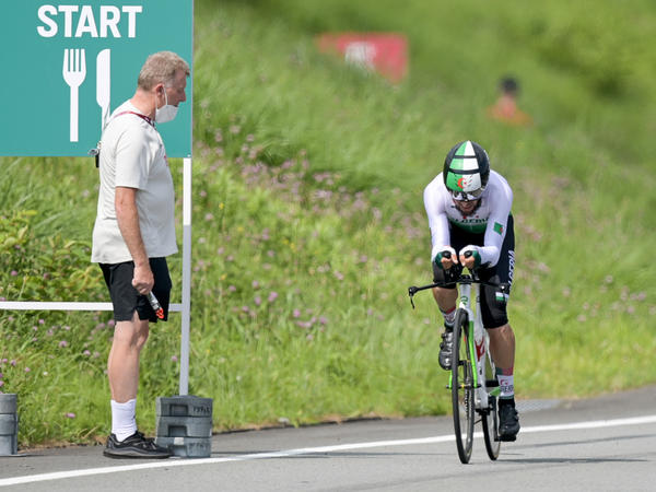 Patrick Moster was fired from his job as sports director of the BDR, the German Cycling Federation after yelling slurs during a race Wednesday. Here, Moster stands next to the track next to cyclist Azzedine Lagab from Algeria — one of the riders a German cyclist was attempting to catch.
