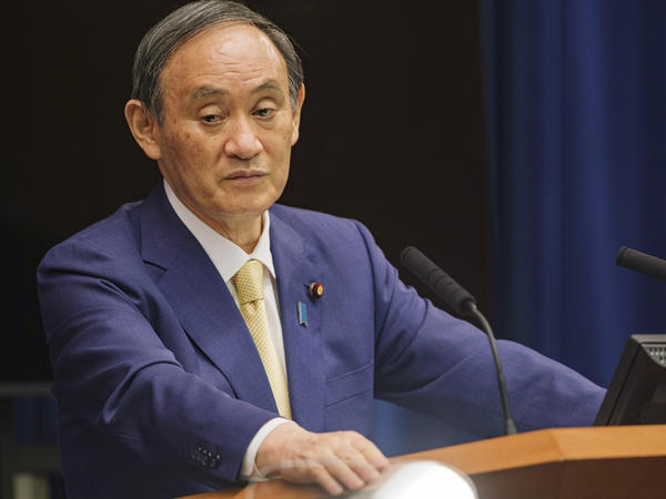 Japanese Prime Minister Yoshihide Suga will extend a state of emergency to four more prefectures due to rising coronavirus infections. Here, Suga addresses a news conference on July 8.