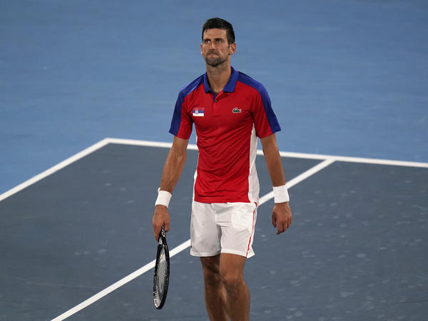 Serbia's Novak Djokovic reacts after he was defeated by Germany's Alexander Zverev during a semifinal match of the tennis competition on Friday at the Summer Olympics.