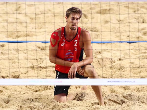 Taylor Crabb, shown here during a 2019 beach volleyball match, tested positive upon arrival to Tokyo and was not able to compete at the Olympic Games.