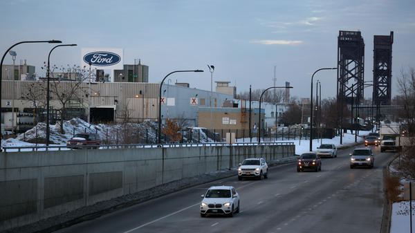 The Ford company logo is displayed above the Chicago Assembly Plant on Feb. 3. Ford is allowing many workers to work remotely — not just during the pandemic, but as routine policy. But of course, plant workers can't sign in to work from home.