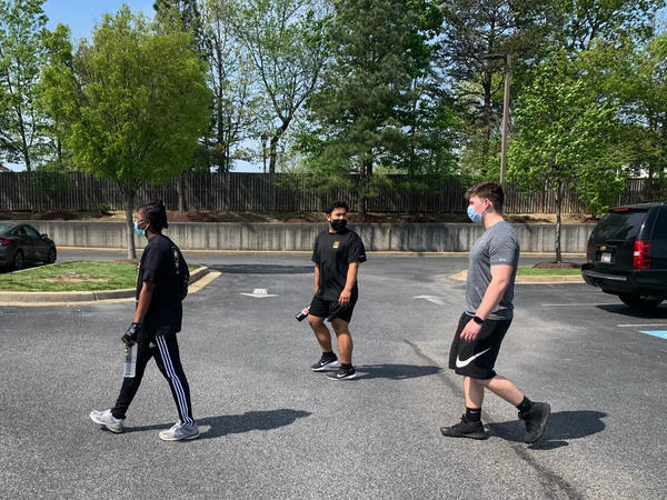 Marcus Robinson (center) wanted to enlist in the Army but was too heavy to qualify for the military's fitness standards. So he started to get in shape — showing up at an Army recruitment office in Waldorf, Md., for weekly workouts in the parking lot.