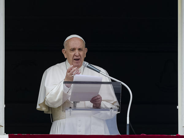 Pope Francis speaks from the window of his studio overlooking St. Peter's Square on Sunday. Francis expressed sorrow for the treatment of Indigenous people in Canada, but did not offer an apology.