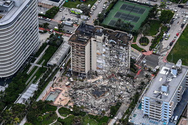 An aerial view shows search and rescue personnel working on site after the partial collapse of the Champlain Towers South in Surfside, north of Miami Beach, on Thursday.