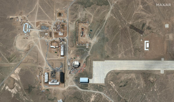 This image from June 28, 2021 shows about a dozen large buildings are under construction at the mysterious, remote airfield.