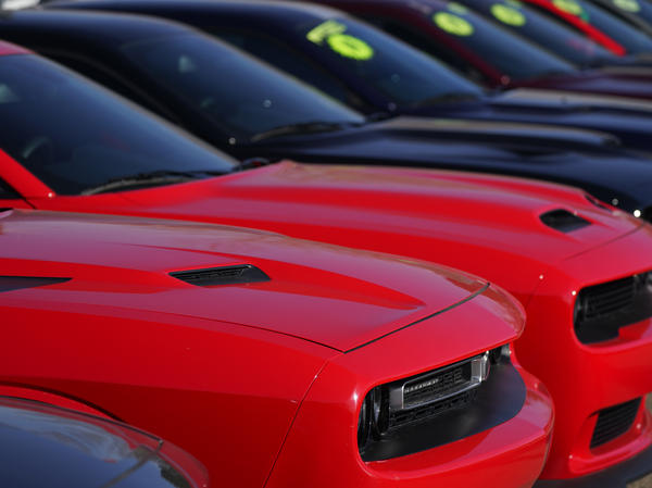 Used Challengers sit in a long line at a Dodge dealership on Jan. 24 in Littleton, Colo. Used car prices may be peaking and that could help reinforce hopes for easing inflation.