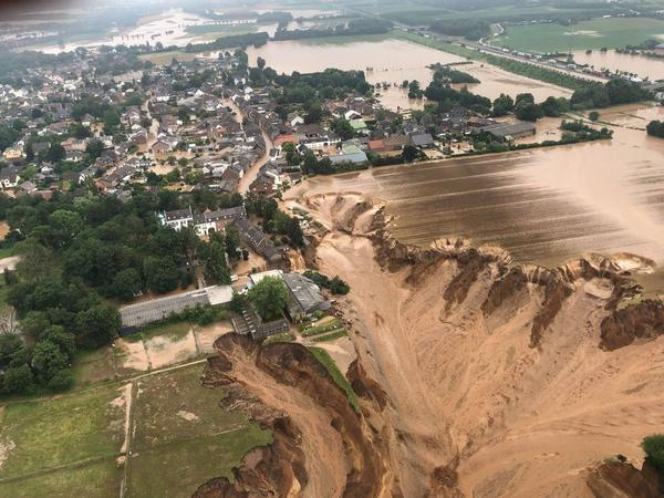 Flooding has led to the collapse of an entire field in Rhein-Erft-Kreis, a district in western Germany. Officials have said a warming climate is at least partially to blame for floods.