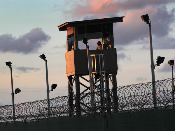 A U.S. military guard tower stands on the perimeter of the detainee camp on September 16, 2010, in Guantánamo Bay, Cuba. There are now 39 detainees remaining after the prisoner transfer on July 19, 2021.