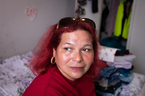 María Lara sits in her bedroom in the Bedford and Victoria Station apartment complex in Langley Park, Md., a densely populated, low-income suburb of Washington, D.C.