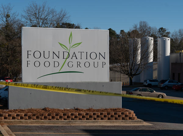 Tanks of liquid nitrogen are seen at the Foundation Food Group poultry processing plant in Gainesville, Ga. Six workers died after a freezer malfunctioned in January 2021.
