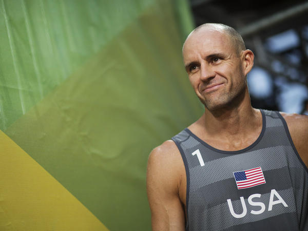 U.S. beach volleyball player Jake Gibb, shown here in 2016, is continuing to compete in the Tokyo Olympics after his partner tested positive for the coronavirus.
