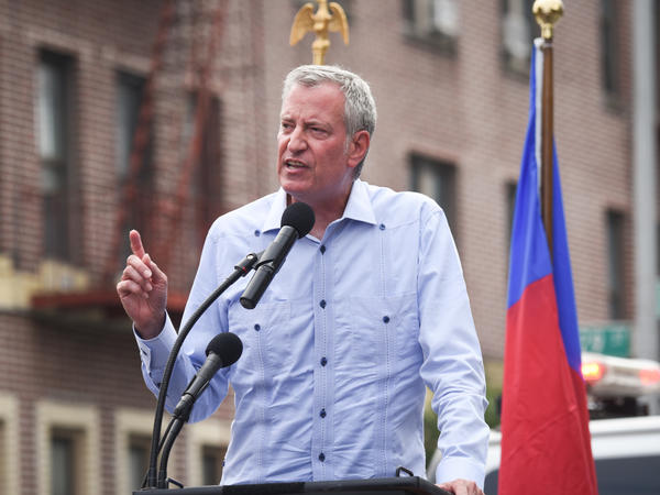 New York City Mayor Bill de Blasio said Monday that city workers will be required to be vaccinated or get tested weekly for COVID-19. De Blasio is seen here in Brooklyn on Sunday at a rally in support of Haiti.