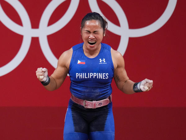 Hidilyn Diaz of the Philippines celebrates winning the women's 55-kilogram weightlifting match at the Tokyo 2020 Games — her country's first Olympic gold medal.
