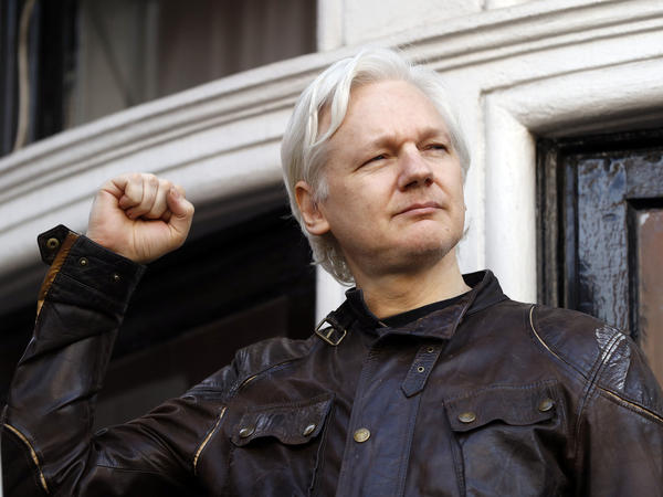 In this Friday May 19, 2017 file photo, Julian Assange greets supporters outside the Ecuadorian embassy in London. Britain's High Court on Wednesday July 7, 2021, has granted the U.S. government permission to appeal a decision that WikiLeaks founder Julian Assange cannot be sent to the United States to face espionage charges.