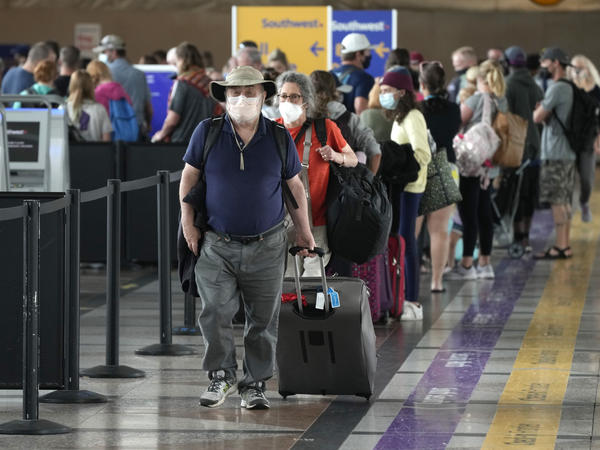 Travelers head to a security checkpoint at Denver International Airport on July 2. The economy likely surged in the April-June quarter as vaccine rollouts sparked a surge in pent-up activity. A slowdown is now seen as inevitable, although the pace of growth should remain strong.