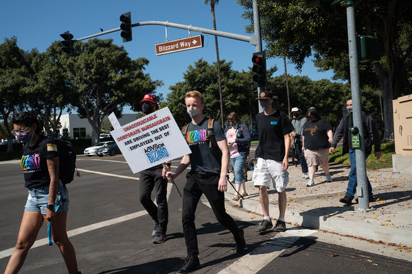 Employees walk across Blizzard Way during a walkout at Activision Blizzard offices in Irvine, Calif., on Wednesday.