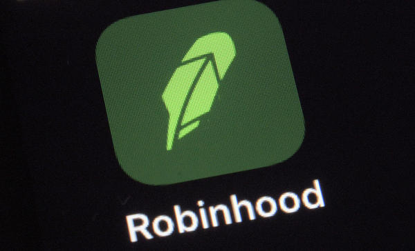 A Dec. 17, 2020 photo shows the logo for the stock trading Robinhood app on a smartphone in New York. Robinhood will make its debut on the Nasdaq on Thursday, just as state and federal regulators continue probes into the company.