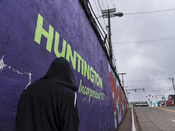 A pedestrian walks past a mural in Huntington, W.Va., on March 18. Huntington was once ground zero for the U.S. opioid epidemic.