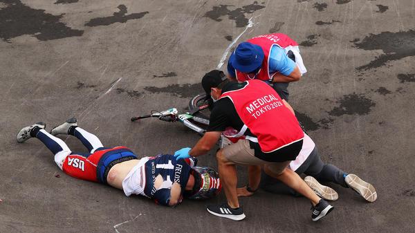 U.S. BMX racer Connor Fields receives medical treatment after a crash during a men's BMX semifinal heat at the Ariake Urban Sports Park in Tokyo.