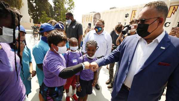 U.S. Education Secretary Miguel Cardona visits a summer program at a Los Angeles school in mid-July.