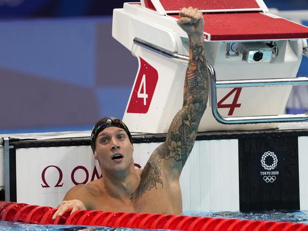 U.S. swimmer Caeleb Dressel celebrates winning the men's 100-meter butterfly final at the Tokyo Olympics.