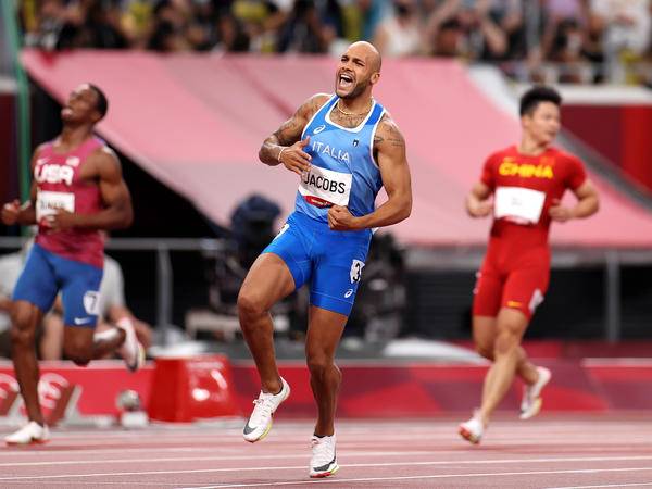 Italy's Marcell Jacobs celebrates after winning the men's 100 meter final at the Tokyo Olympic Games.