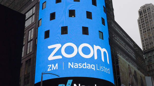 A sign for Zoom Video Communications is pictured ahead of the company's Nasdaq IPO in New York in 2019. The company has agreed to a preliminary settlement in a privacy lawsuit.
