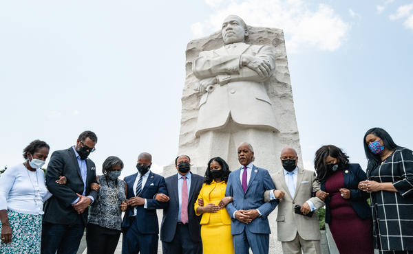 Civil rights leaders and members of the Texas Legislature last week at the Martin Luther King Jr. Memorial in Washington, D.C. They were meeting to discuss actions to stop restrictive voting measures.