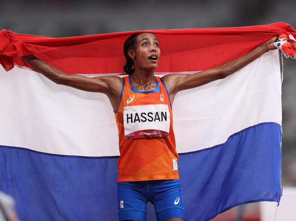 Sifan Hassan of Team Netherlands celebrates as she walks the track with her country's flag after winning the gold medal in the women's 5,000-meter final on Day 10 of the Tokyo Games.
