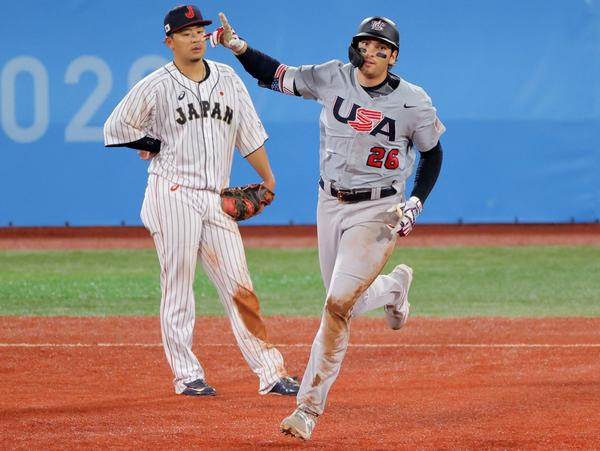 Team USA's Triston Casas trots the bases Monday after hitting a three-run homer against Japan as Hideto Asamura watches. Japan came back to defeat the U.S. 7-6 in extra innings at the Tokyo Olympics.