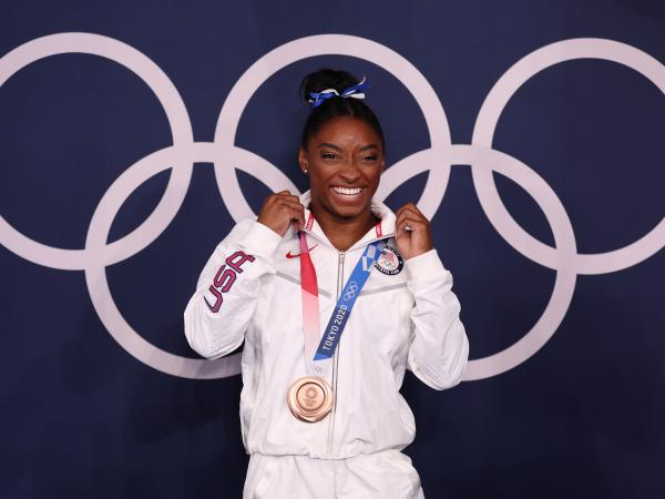 U.S. gymnast Simone Biles won a bronze medal Tuesday in the women's balance beam final at the Tokyo Olympic Games.