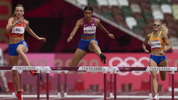 Sydney McLaughlin of the United States wins the women's 400-meter hurdles final at the Summer Olympics in Tokyo.