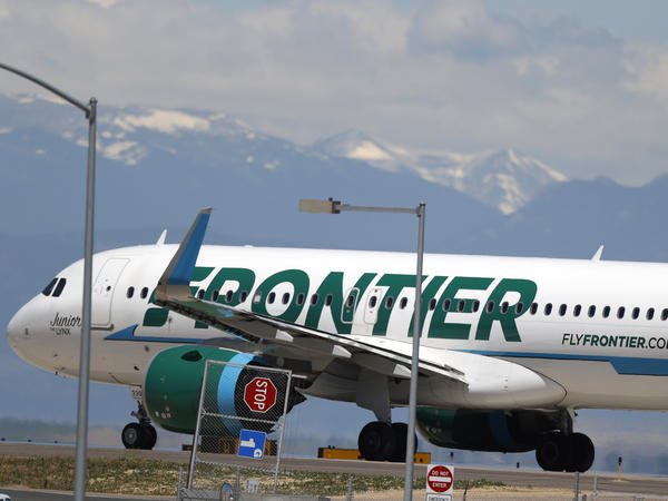 A Frontier Airlines aircraft at Denver International Airport in 2020. A 22-year-old passenger faces three misdemeanor charges after allegedly groping two flight attendants and assaulting a third.