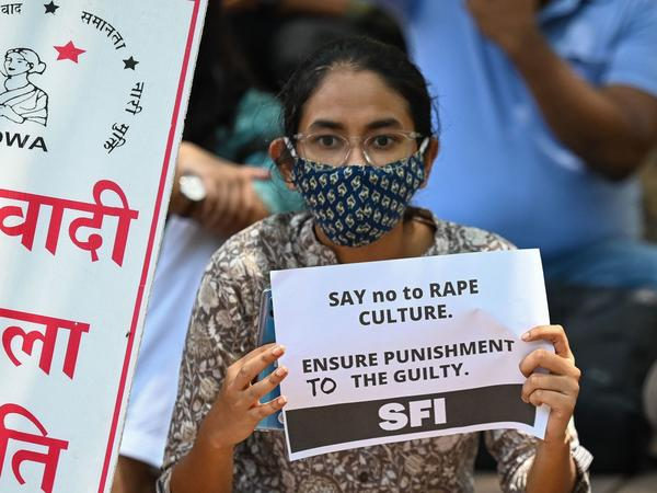 Activists hold placards during a protest Wednesday over the death of a 9-year-old girl in New Delhi. The girl's parents have accused a Hindu priest and three other men of raping and killing the child.