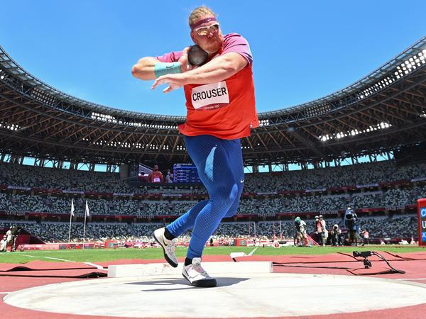USA's Ryan Crouser competes in the men's shot put final during the Tokyo 2020 Olympic Games at the Olympic stadium on Thursday. Three of his six throws broke the Olympic record.