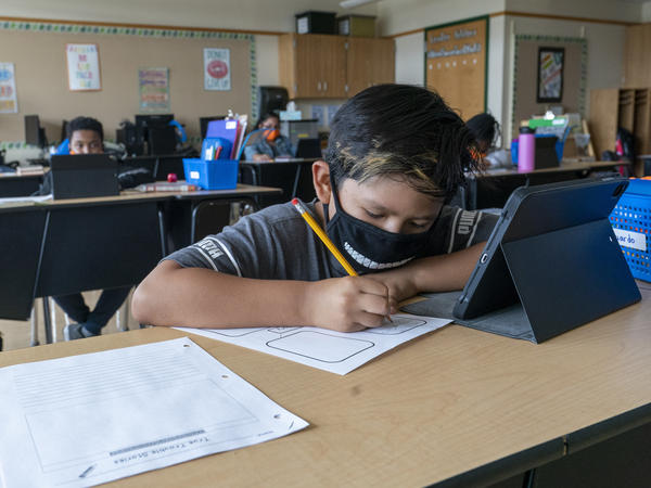A student wears a face mask while at the Post Road Elementary School in White Plains, N.Y., last October. A recent study found the number of children contracting the coronavirus is on the rise.