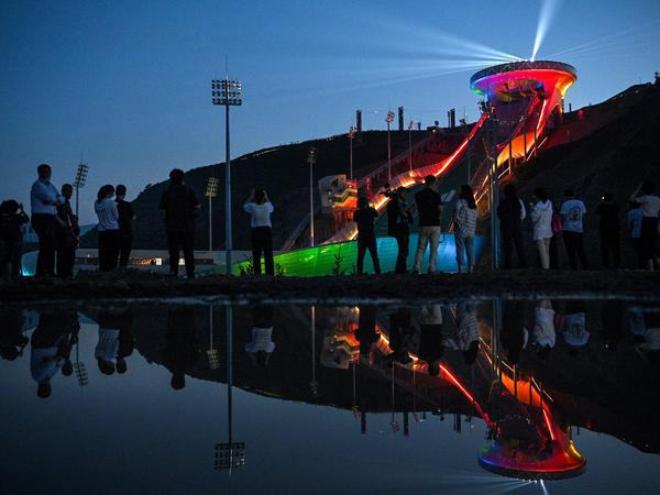 The Beijing Winter Olympics are set to open in February. Visitors recently watched a light show at the newly built ski jumping center in northern China's Hebei province.
