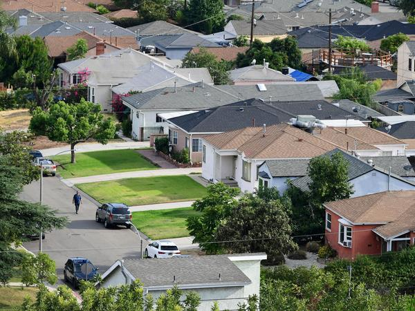 A man walks through a neighborhood of single-family homes in Los Angeles last week. The CDC announced a new temporary eviction ban a few days after the previous one expired.