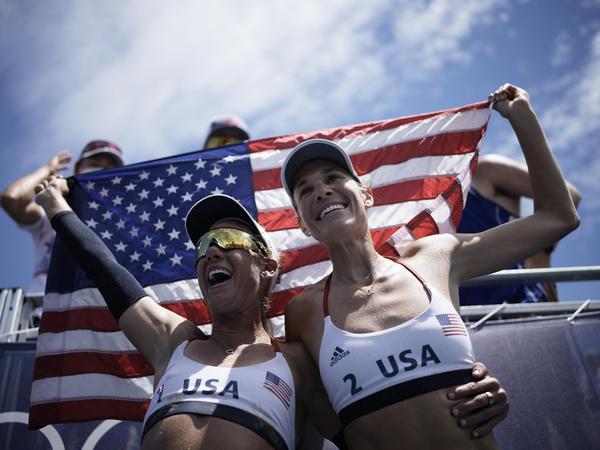U.S. beach volleyball pair April Ross (left) and Alix Klineman celebrate winning a women's beach volleyball gold medal in a match against Australia at the Summer Olympics in Tokyo.