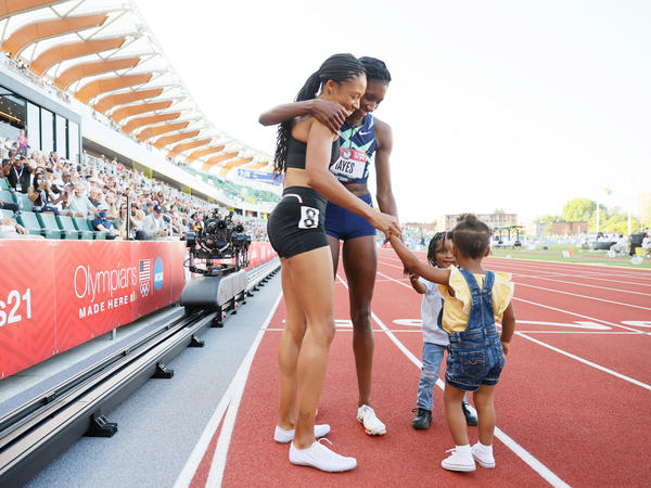 Allyson Felix and Quanera Hayes celebrate with their children after placing second and first respectively in the women's 400-meter final at U.S. Olympic Track & Field Team Trials in June in Eugene, Ore.