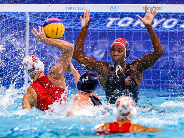 U.S. water polo player Ashleigh Johnson defends a shot during the gold medal match at the Tokyo Olympics.