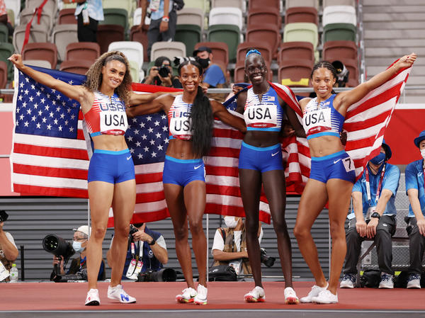 U.S. runners (from left) Sydney McLaughlin, Dalilah Muhammad, Athing Mu and Allyson Felix celebrate winning the gold medal in the women's 4x400 meter relay at the Tokyo Olympic Games.