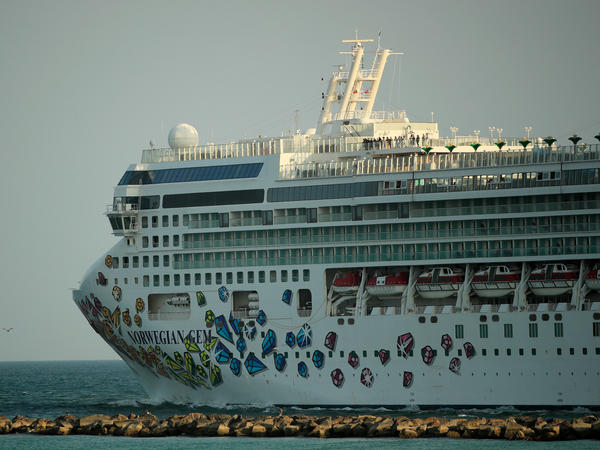 The Norwegian Gem cruise ship leaves the Port of Miami in April 2020. The Norwegian Gem's first trip since a pandemic-induced hiatus is scheduled to sail from Miami on Aug. 15.
