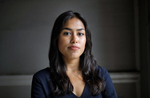 Tashrima Hossain, who used to work on Wall Street, but quit to join Facebook, is part of a growing number of young people who are no longer attracted to investment banking despite surging salaries. She posed for a portrait at Alamo Square in San Francisco on Aug. 11.