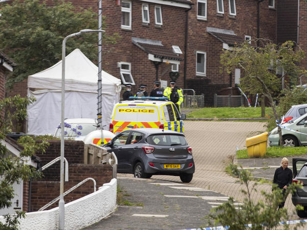 Police work the scene after a deadly shooting in Plymouth, England, on Thursday.