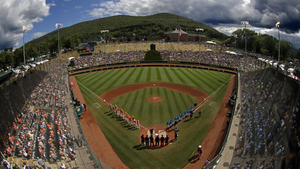 One year after the Little League World Series was canceled due to the COVID-19 pandemic, the upcoming series will be played without spectators from the general public. Here, players are seen on the field at Lamade Stadium in South Williamsport, Pa., during the tournament's 2019 edition.