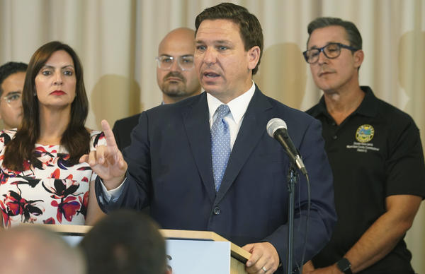 Florida Gov. Ron DeSantis, here at a news conference Tuesday, has announced plans for a state-run mobile unit providing monoclonal antibody treatments.